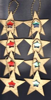 8 Gold Christmas Stars with red & green jewels . *